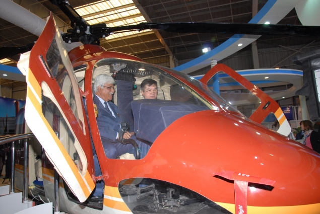 Locke and And Ambassador Roemer in HAL helicopter