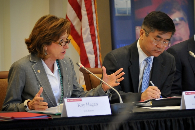 US Senator Kay Hagan (left) welcomes everyone to NC State while Secretary Gary Locke makes notes.