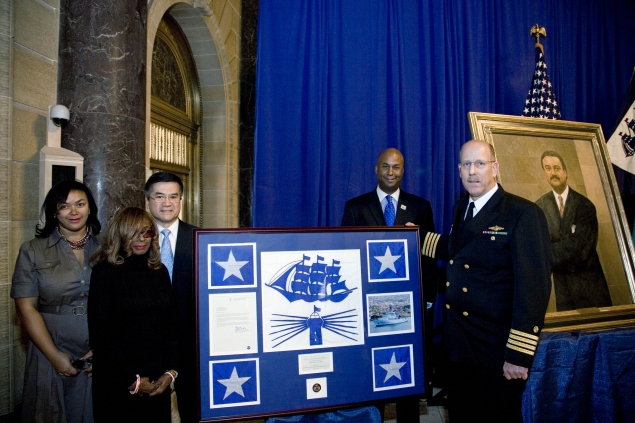 The Brown family joins Secretary Locke for a presentation of the NOAA flag that was flown aboard the NOAA ship Ronald H. Brown.