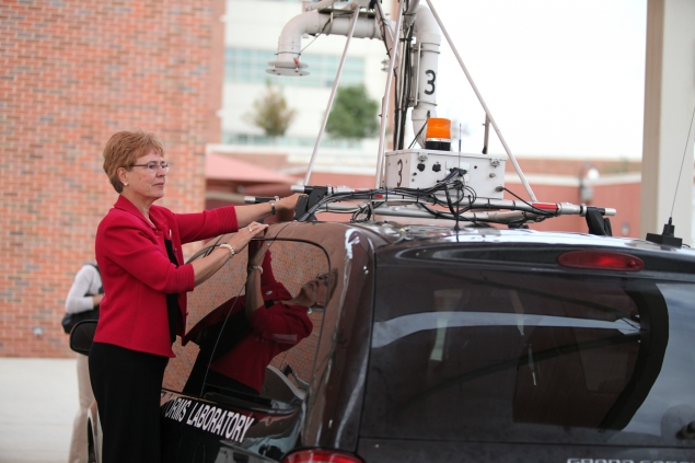 Dr. Lubchenco Inspecting Instruments on a Mobile Mesonet Vehicle from NOAA's National Severe Storms Laboratory.