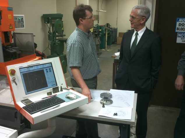 Secretary Bryson stops to speak with a computer operator at Schlegel Systems, Inc.