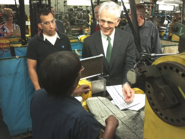 Secretary Bryson chats with a worker at Schlegel Systems, Inc.