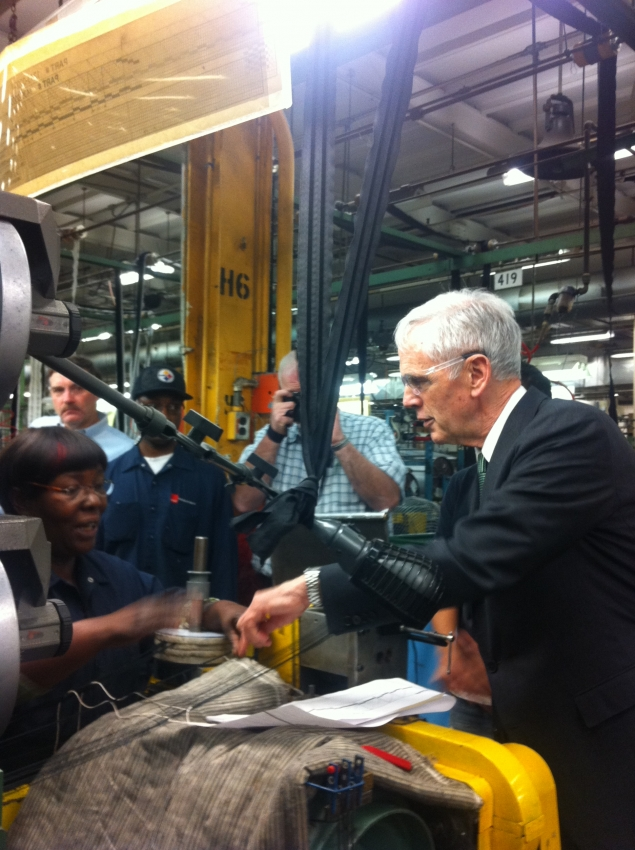 Secretary Bryson asks a worker at Schlegel Systems, Inc. about her machine