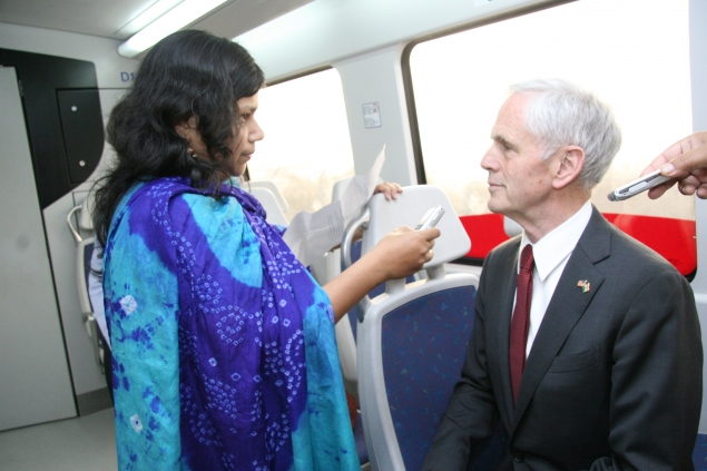 Secretary Bryson taking questions while riding the Delhi Metro