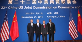 Vilsack, Bryson, Wang and Kirk in stage with JCCT logo