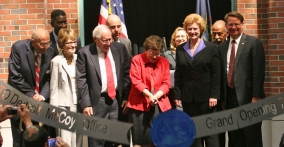 Acting Secretary Rebecca Blank cuts the steel ribbon, officially opening the Elijah J. McCoy USPTO Satellite Office