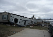 Image of upside down mobile home after a tornado has struck. Click for larger image.