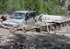 Image of van trapped in debris. Click for larger image.