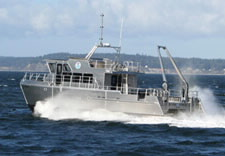 Image of the R/V Bay Hyrdo II speeding through the water. Click for larrger image.