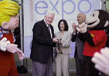 (Posing left to right): Dennis the Menace, Congressman Jim Moran, Debbie Cohn, John Doll and Curious George officially open the 2009 National Trademark Expo. Click for larger image.
