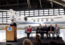 Secretary Locke and officials at airport with NOAA plane in background. Click for alrger image