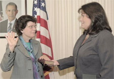 Photo of Under Secretary Rebecca Blank being sworn in by Director of Executive Services Denise A. Yaaag.