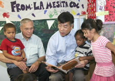 Secretary Locke is shown reading to children with Rep. Harry Mitchell. Photo courtesy Tracy Hayes. Click for larger image.