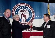 Acting Census Bureau Director Thomas Mesenbourg (third from left) is shown with ceremonial scissors. Also shown (L to R) are Ken Asbury of Lockheed Martin, James Sheaffer of CSC, and Rick Ruiz of Lockheed Martin. Click for larger image.