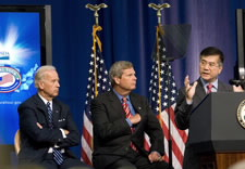Biden, Vilsack and Locke on stage with flags in background. Click for larger image.