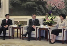 Pictured seated are Locke, Energy Secretary Steven Chu and State Councilor Liu Yangdong at the Great Hall of the People. Click for larger picture.