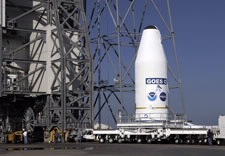 The spacecraft is transported to the launch site on large truck beds. Click for larger image.