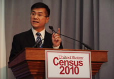 Locke speaking before audience with Census 2010 logo.