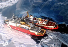 Image of U.S. and Canada Coast Guard icebreakers side by side. Click for larger image.