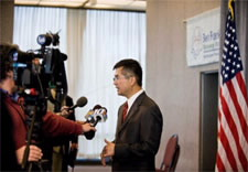 Secretary responds to questions from the media. Click for larger image.