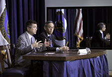 Locke and Chu seated at table responding to auidence questions. Click for larger image.