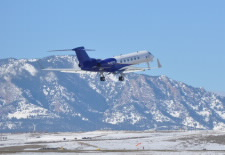 Image of research plane with mountains in the background. Click for larger image.