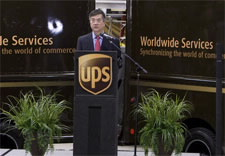 Secretary Locke with UPS vehicles. Click for larger image.