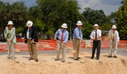Officials with shovels at groundbreaking ceremony