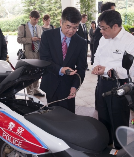 Secretary Locke looking at a Vectrix electric motorcycle.