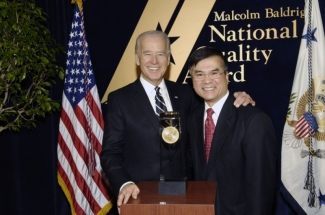 Biden and Locke pose on podium