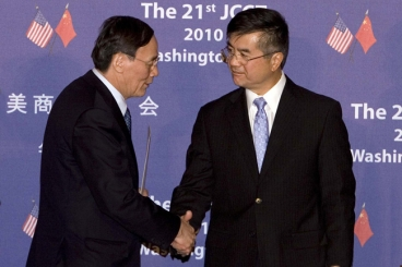 Wang and Locke shaking hands